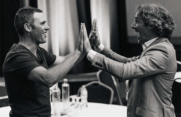 Dietitian Shane Jeffrey high fiving Glenn Mackintosh at Dietitian Connection conference 2018